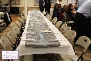 long table with dinnerware and glasses